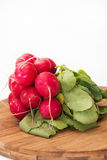 Stack of red radish on wooden board.  Royalty Free Stock Photography