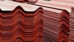 Stack red roof tiles, raw material for industrial of construction. Stock footage. Warehouse with red roof tiles stock footage