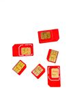 Stack of red sim card on white background Royalty Free Stock Images