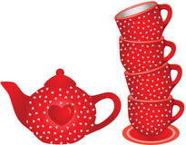 Stack of red tea cups and teapot with hearts Royalty Free Stock Images