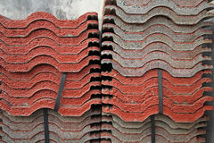 Stack of red tiles for construction Stock Photo