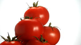 Stack of red tomatoes stock video
