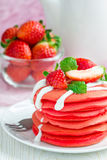 Stack of red velvet pancakes with yogurt and strawberry on a white plate, vertical Royalty Free Stock Photos