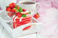 Stack of red velvet pancakes with yogurt and strawberry on on a wooden tray, horizontal, copy space Stock Images