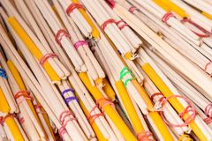 Stack of red and yellow incense sticks in a buddhist temple.Thai Stock Images