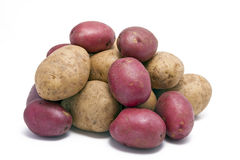 Stack of Regular and Red Skinned Potatoes Royalty Free Stock Photography