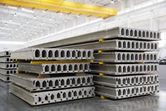 Stack of reinforced concrete slabs in a factory workshop. Stack of precast reinforced concrete slabs in a house-building factory workshop Stock Photos