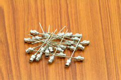 Stack of reuse iron needle No.18 G for drug needle  on wooden fl Stock Photography