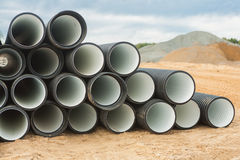 Stack of ribbed pipes Stock Photo