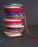 Stack of ribbon rolls Royalty Free Stock Image