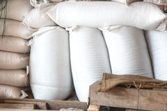 Stack of rice bags. Stack of rice and animal feed bags Stock Photo