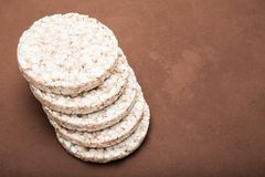 A stack of rice cake on a vintage brown style. Copy space royalty free stock image