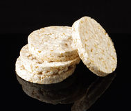 Stack of rice crackers isolated on the black background with reflection Stock Image