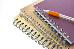 Stack of ring binder book and pen isolated Stock Photo