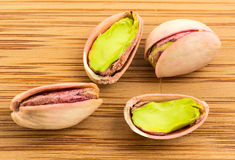 A stack of roasted pistachios on wood Stock Images