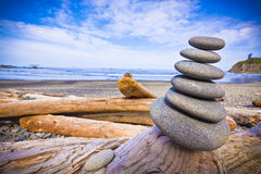Stack of Rocks on Driftwood Stock Photo