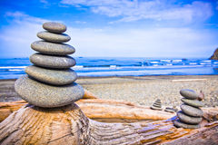 Stack of Rocks Upon Driftwood at Ruby Beach, Washington Royalty Free Stock Photos