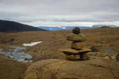 Stack of Rocks in Front of Mountains Stock Image