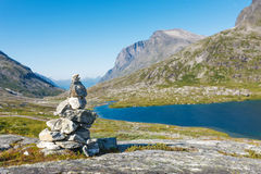 Stack of rocks with mountain and lake view Stock Photos