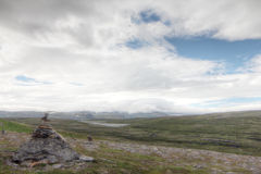 Stack of rocks and Norwegian landscape Stock Images