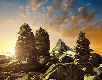 Stack of rocks stones at sunset in the background Matterhorn Stock Image