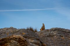 Stack of rocks on top of mountain stock photography