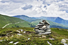 Stack of rocks on the top of mountains Royalty Free Stock Photo