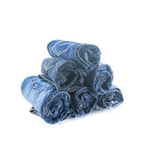 Stack of rolled jeans Stock Photo