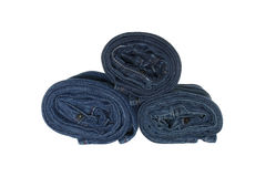 Stack of rolled jeans isolated on white background stock photo