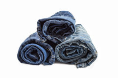 Stack of rolled jeans Stock Images