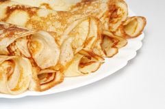 Stack of rolled pancakes. On the plate Stock Photo