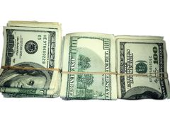 Stack of Rolled US Dollar Bills. On white background Stock Photo