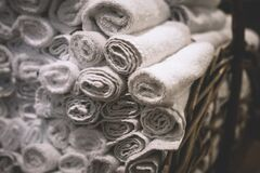 Stack of rolled white bathroom towels Royalty Free Stock Photo