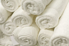 Stack of Rolled White Towels. A large stack of white towels neatly rolled Stock Image