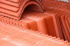 Stack of roof-tiles. On green grass Stock Photo