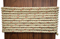 Stack of Rope on Brown wood with white background Royalty Free Stock Photo