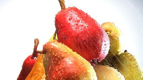 Stack of rotating pears stock footage