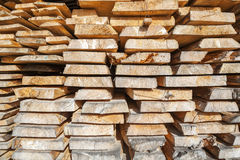 Stack of rough wooden boards in lumberyard Royalty Free Stock Image