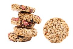 Stack of round candied seeds and nuts. Royalty Free Stock Image