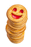 Stack of round cookies with smile isolated Stock Images