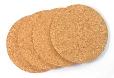 Stack of Round Cork Table Coasters on White Background Stock Image