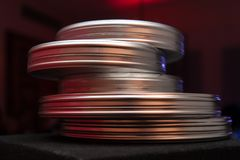Stack of round film cases stock photography