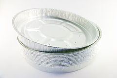 Stack of round high sided catering trays. On a white background Stock Photos