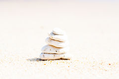 Stack of round smooth stones on a seashore Stock Photos