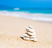 Stack of round smooth stones on a seashore Royalty Free Stock Photo