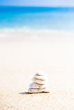 Stack of round smooth stones on a seashore Royalty Free Stock Photos