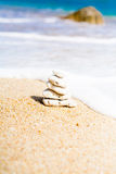Stack of round smooth stones on a seashore Royalty Free Stock Images