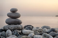 Stack of round smooth stones on a seashore Royalty Free Stock Image