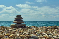 Stack of round smooth stones on a seashore. Relax image. Stock Photos