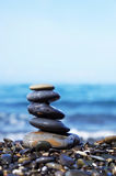Stack of round smooth stones on the seashore Royalty Free Stock Photos